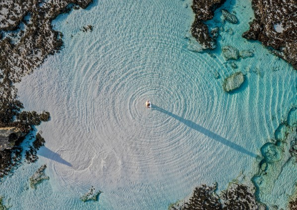 Aerial of Girl in Rock Pool on Kangaroo Island