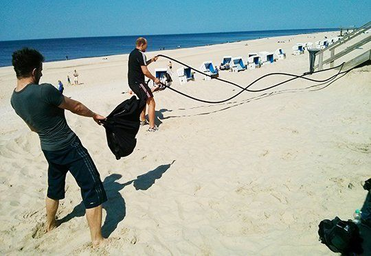 Training am Strand mit blackPack und Battle Rope