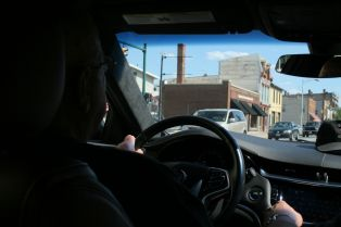 """This is the ring leader at the wheel as we transited downtown heading west. I simply wanted to capture a glimpse of this small city. It could be """"Anywhere USA"""" but it's a special place to me. :)"""
