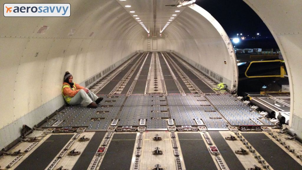 Empty interior of 767 freighter main deck. Cavernous interior with load crew member sitting quietly waiting for cargo to arrive. You might be a cargo pilot... - AeroSavvy
