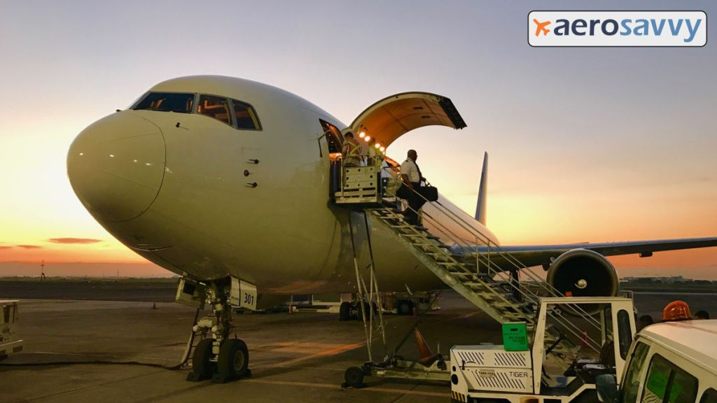 UPS Boeing 767-300F sitting on the apron at Clark Field, Philippines. Silhouette of crew member walking down the stairs. You might be a cargo pilot... - AeroSavvy