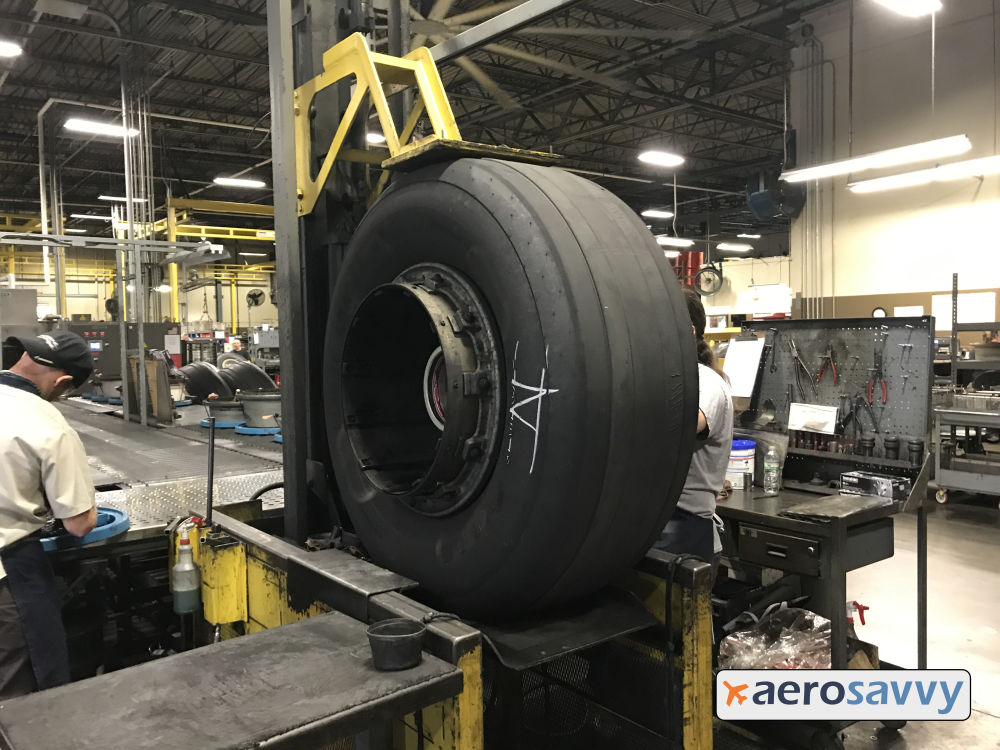 Wheel raised by hydraulic lift to about 4 feet high.