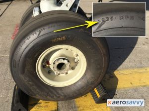 Side wall of a 767 nose wheel tire.  Embossed on the side wall is 235 MPH.