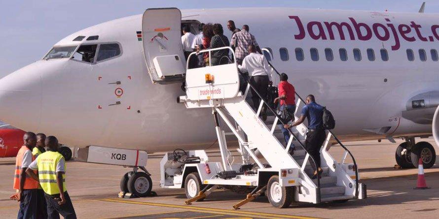 Travellers disembark from Jambojet plane.