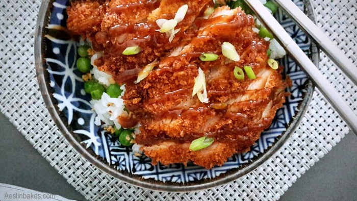 Chicken Katsu with Tonkatsu Sauce over rice with peas and crispy garlic
