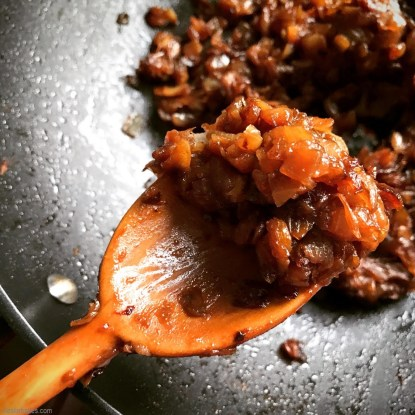 wooden spoonful of caramelized onions