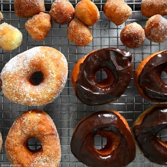 array of brioche doughnuts - vanilla bean sugar doughnuts, cinnamon sugar and chocolate glaze
