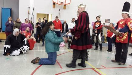 Lady Angel of Gabriel's Landing receives her AoA scroll from Their Majesties. Photo by Baron Liam.