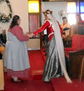 Mistress Kateryna Ty Ysaf receiving a Court Barony. Photo by Mistress Hilderun Hugelmann.