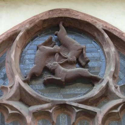 """""""Paderborner Dom Dreihasenfenster"""" by Zefram - Own work. Licensed under GFDL via Wikimedia Commons - http://commons.wikimedia.org/wiki/File:Paderborner_Dom_Dreihasenfenster.jpg#/media/File:Paderborner_Dom_Dreihasenfenster.jpg"""