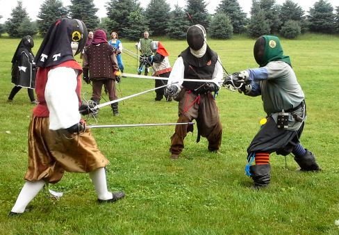 Fencers practicing 3-on-1 melees