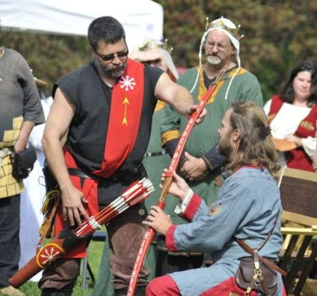 Lord Hrolf is named Archery Champion. Photo by Baron Steffan.