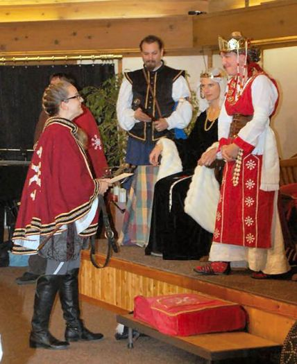 THLady Fiora is invested as Rapier Champion. Photo by Lady Àine ny Allane.