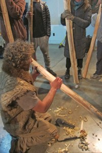 Demonstrating how to safely remove bark.