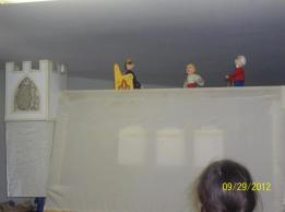 """A scene from """"The Peasant's Clever Daughter"""" done with rod puppets"""