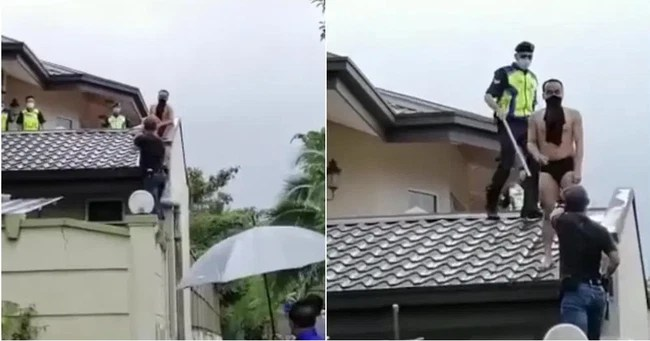 Stealing and being chased to death by the host dog, the man jumped onto the roof, no one could help laughing when he saw the appearance of his arrest - Photo 2.
