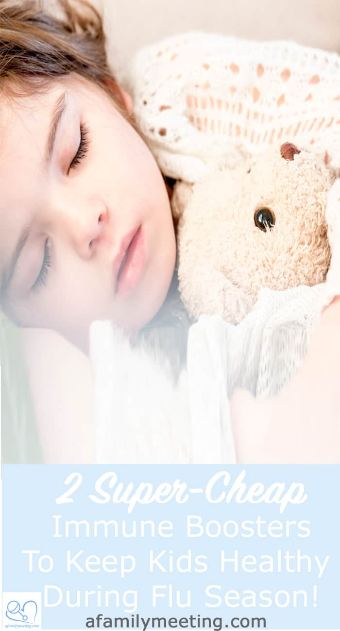 healthy girl sleeping peacefully while holding teddy bear