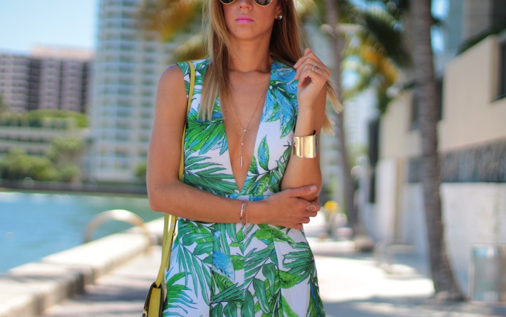 amanda tur a miami lifestyle and fashion blogger wearing palm print romper during an outing in miami florida by downtown miami with 4 months old yorkie teacup penelope tur