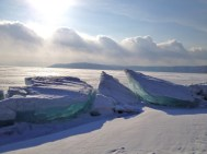 Impressive ice sculptures formed round the edge of the lake, and glowed blue in the sun light.