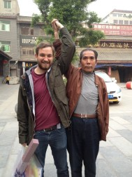 A strange interaction with a Hui guy in the Muslim Quarter. He span me round for a while, then instigated this pose and made Amy take a picture.