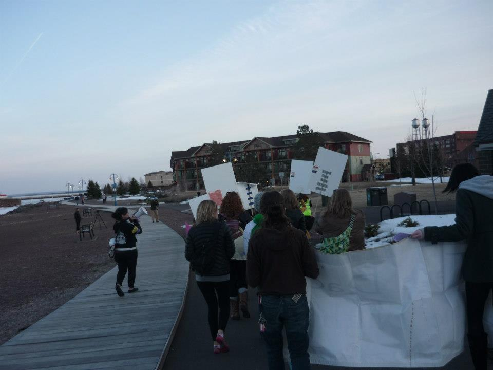 Ava with a megaphone leading the Take Back the Night March in Duluth, MN