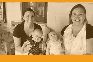 Moms holding babies at Missouri mini Holy Family Fest