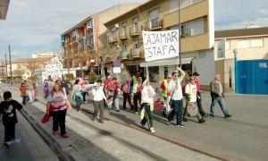 stop desahucios en la entrada a Armilla. Marcha a Almería