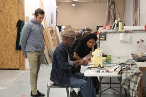 Nene Diallo with studio visitors in fall 2019