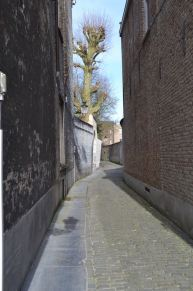 """The alley ways (through which Colin Farrell wanders in the dude flick """"In Bruges""""--sample dialogue: Ken: [preparing to climb the bell tower]: Coming up? Ray: What's up there? Ken: The view. Ray: The view of what? The view of down here? I can see that from down here. Ken: Ray, you are about the worst tourist in the whole world. Ray: Ken, I grew up in Dublin. I love Dublin. If I grew up on a farm, and was retarded, Bruges might impress me but I didn't, so it doesn't."""