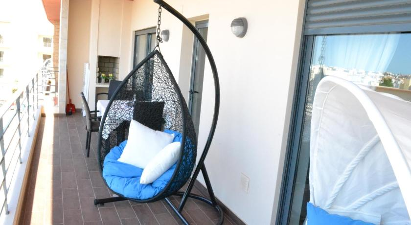 swing chair lagos rocking for nursery target encosta da marina apartment bedandbreakfast eu rua das caravelas lote 3 1e frente