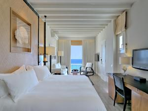 wicker chairs with ottoman underneath wheelchair in arabic santa marina, a luxury collection resort hotel review, mykonos, greece   telegraph travel
