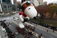 NEW YORK - NOVEMBER 25: The Snoopy float glides down Central Park South during the Macy's Thanksgiving Day parade November 25, 2010 in New York City. This year's annual parade features approximately 8,000 participants, 15 giant character balloons and 43 novelty balloons. (Photo by Chris Hondros/Getty Images)