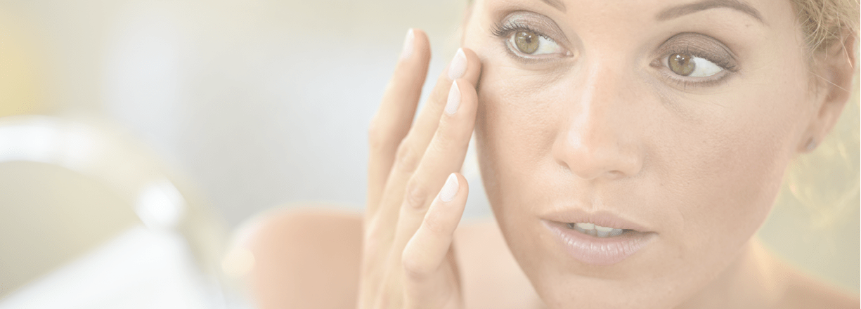 Woman apply skin care products