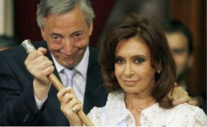 Argentine President Nestor Kirchner, left, transfering power to his wife Cristina on her inauguration day in 2007