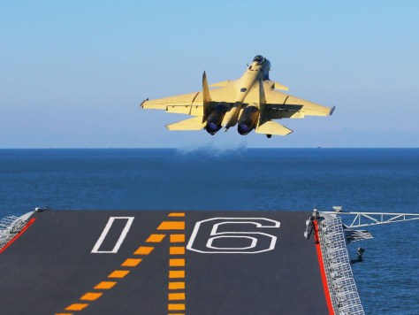 A PLAN J-15 Fighter Takes Off from the Deck of China's First Carrier, the Liaoning
