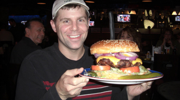 Shawn Collins about to eat a giant hamburger
