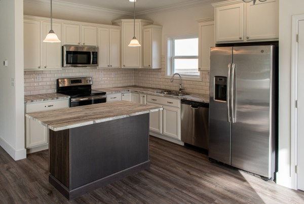 modular home kitchen with quartz counter tops