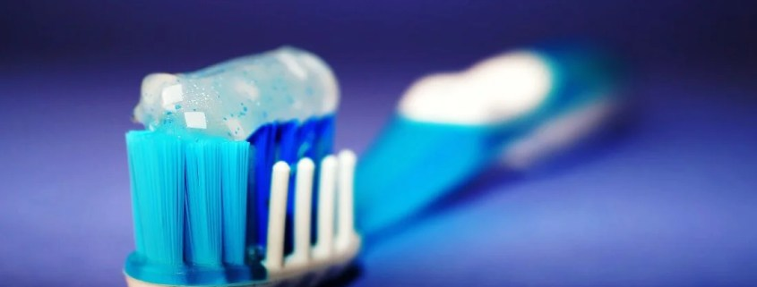 close up of a toothbrush with tooth paste on it