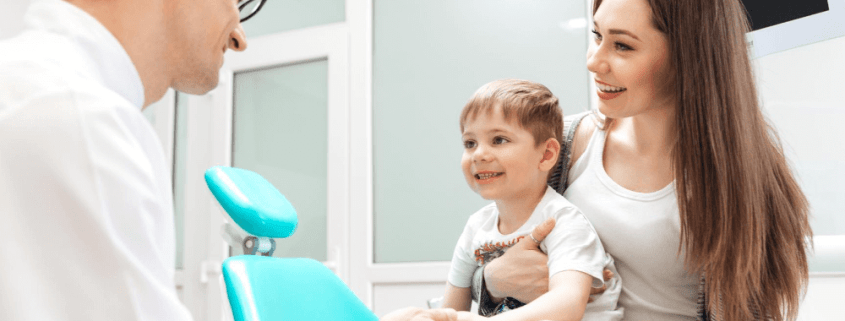 woman and her child sit in a dentists office with their faimly dentist