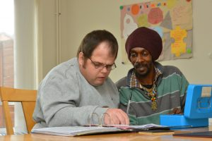 Paul reviewing his budget with Jermaine