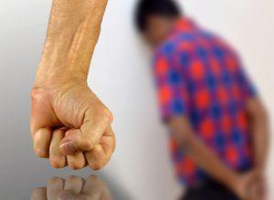 man showing fist near refugee