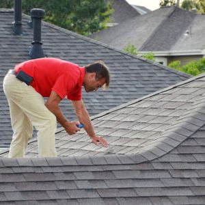 showing a representative performing a roof inspection on a shingle roof