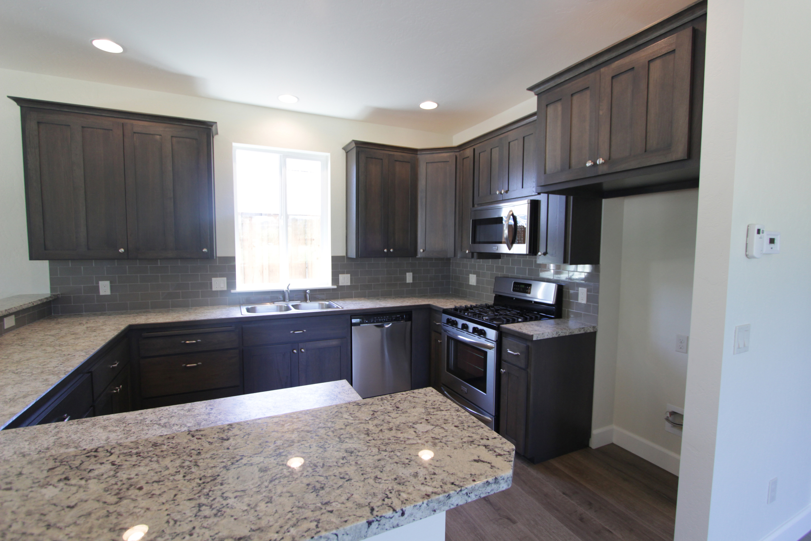 hickory shaker style kitchen cabinets best wood stain for affordable custom showroom