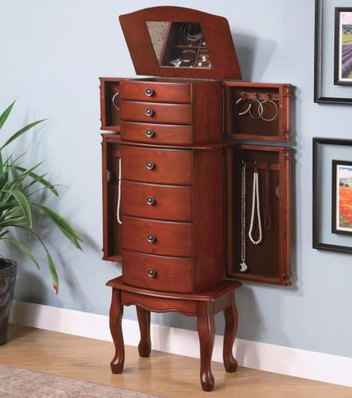 Warm brown finish Brown felt lined doors and drawers Antique bronze hardware Flip top mirror