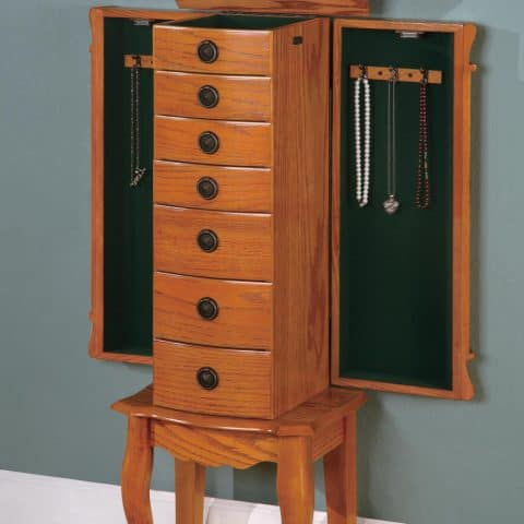 Classic style jewelry armoire Flip top mirror Two felt-lined doors and drawers