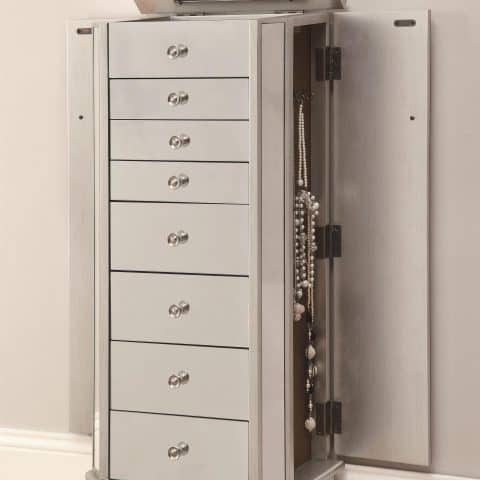 Modern jewelry armoire Features mirrored surface Two doors, seven drawers Flip top mirror Light mocha felt-lined