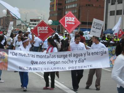 """""""From our mountains surge the water and the energy that they deny us every day."""" There can be no just peace without land reform and the protection of Colombia's natural resources utilized for the good of the people above the profits of the wealthy and the transnational corporations. Photo by James Jordan."""