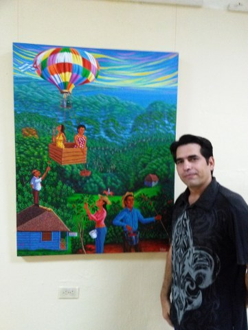 Elio Fernandez Lugo with one of paintings