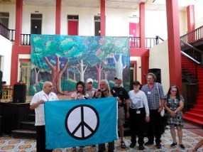 Members of the US Peace Council present flag to the Cuban Peace Council