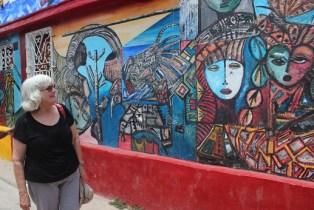 Delegate Pamela Brubaker looks at one of many murals to be found around Havana